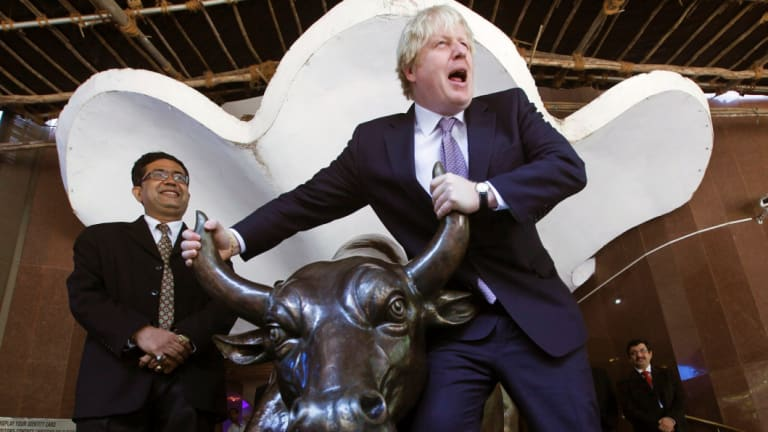Raging bull: Boris Johnson, pictured right in 2012 during his time as mayor of London, pioneered journalism about the European Union in the 1980s and 1990s that 'bore scant relation to the truth'.