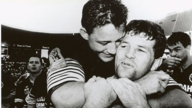 Royce Simmons and Mark Geyer celebrate their 1991 grand final victory.