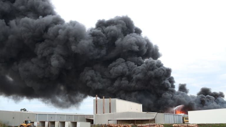 Smoke billows from the blaze in West Footscray.