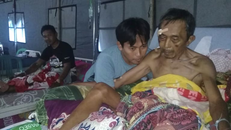 Patients are treated at a makeshift hospital in Poso, Central Sulawesi, Indonesia, on Saturday.