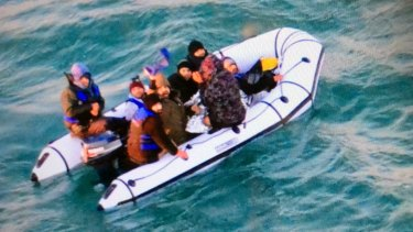 Migrants aboard a rubber boat after being intercepted by French authorities off the port of Calais on Christmas Day.