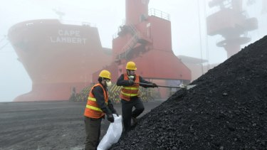 Inspection and quarantine workers take samples of imported coal at a port in Rizhao in eastern China's Shandong province in 2010.