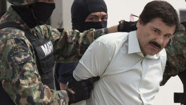 Guzman is escorted to a helicopter by Mexican security forces at Mexico's International Airport in Mexico City in February, 2014.