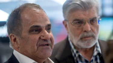 Khalil Eideh (left) with Senator Kim Carr.