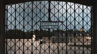 The entrance gate of the first Nazi concentration camp, Dachau, with the inscription 'Work sets you free' (Arbeit macht frei).