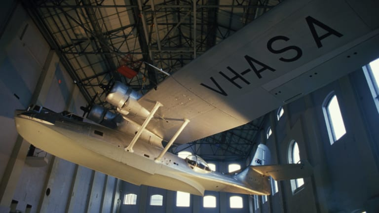 The Catalina Flying Boat is anchored to the roof of the Powerhouse Museum.