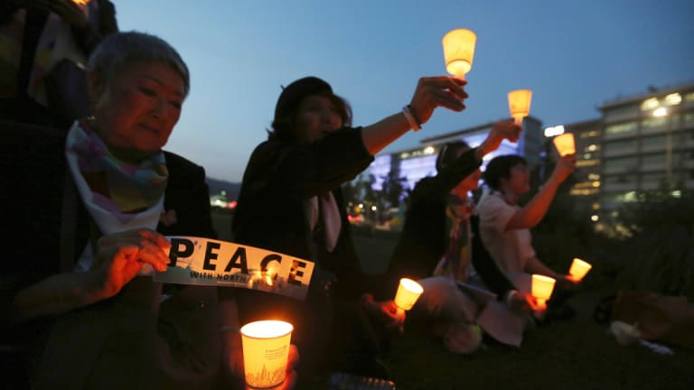 Protesters hold candle lights during a rally to denounce the United States' policies against North Korea near the U.S. embassy in Seoul last month.