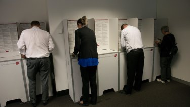Voters lodge early votes at an Early Voting Centre ahead of the Victorian state election on November 25, 2014 in Melbourne.