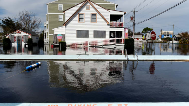 A swimming pool sits next to homes surrounded by floodwaters after Hurricane Florence.