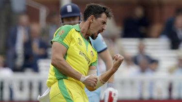An explosive Mitchell Starc celebrates a wicket.