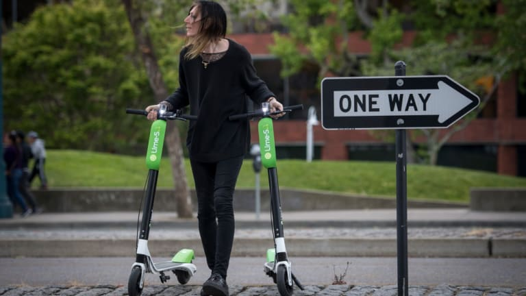 Livia Looper pushes LimeBike scooters in San Francisco, California, in May this year.
