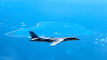 In this undated photo released by Xinhua News Agency, a Chinese H-6K bomber patrols the islands and reefs in the South China Sea.