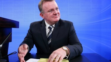 Small Business Minister Bruce Billson commenced taking a salary from the Franchising Council of Australia before he had left parliament.