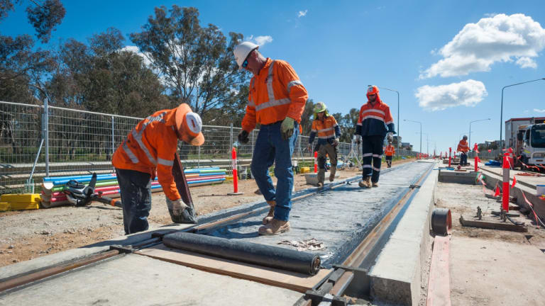 Workers construct the Canberra light rail.