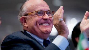 All smiles: Rudy Giuliani became a human smoke screen for the president.