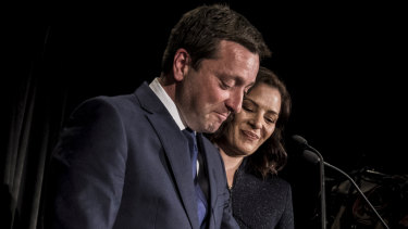 Matthew Guy concedes with the support of his wife Renae on Saturday night.