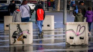 Stencilled concrete bollards on Southgate Promenade.