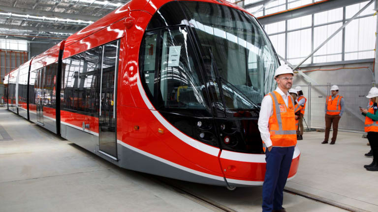 ACT chief minister Andrew Barr with Canberra's first light rail vehicle at its depot in Mitchell.