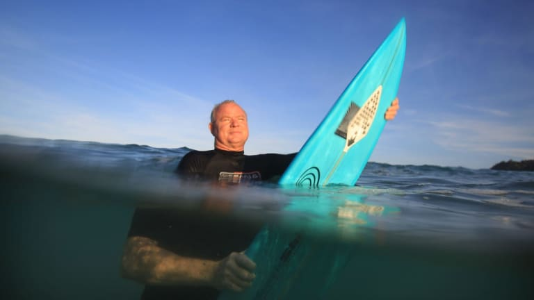 Shark Shield chief executive Lindsay Lyon with the electrical shark deterrent device attached to his surfboard.