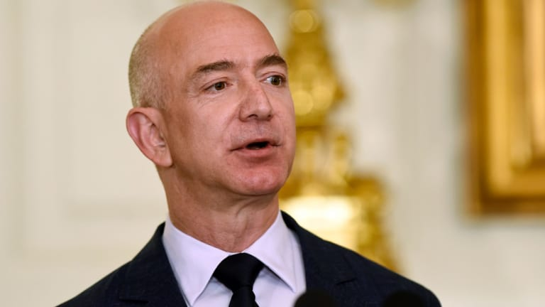 Amazon's Jeff Bezos... on paper his company's soaring share price has made him America's richest man.