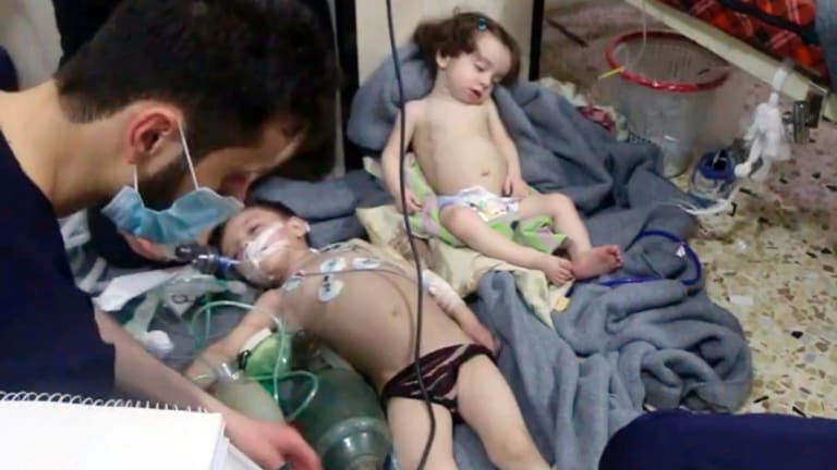 Medical workers treat children following an alleged poison gas attack in the opposition-held town of Douma, in eastern Ghouta, near Damascus, in April..