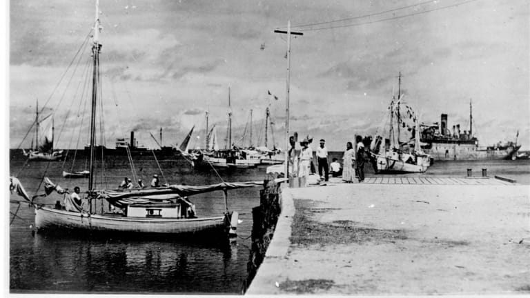 """People on a dock in Jaluit Atoll, Marshall Islands. The documentary """"Amelia Earhart: The Lost Evidence"""" argues that Earhart and her navigator, Fred Noonan, crash-landed in the Japanese-held Marshall Islands, were picked up by Japanese military and that Earhart was taken prisoner."""