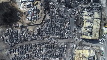 An aerial photo showing burnt vehicles filling a junkyard after being hit by a massive forest fire in Sokcho, South Korea.