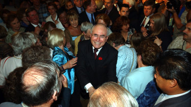 John Howard celebrates his 2001 election victory.