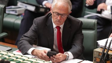 Former prime minister Malcolm Turnbull on his mobile phone.