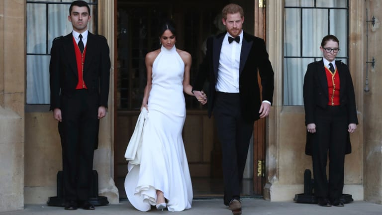 The newly married Duke and Duchess of Sussex, Meghan Markle and Prince Harry, attend an evening reception at Frogmore House following their wedding.