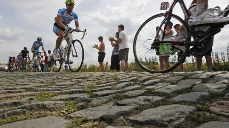 Rough going: Tour riders will have to negotiate cobbled sections such as this from the famed Paris-Roubaix classic.
