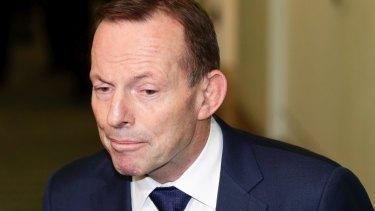 Tony Abbott exits the party-room meeting on Friday.