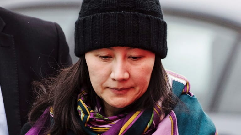 Huawei chief financial officer Meng Wanzhou arrives at a parole office.