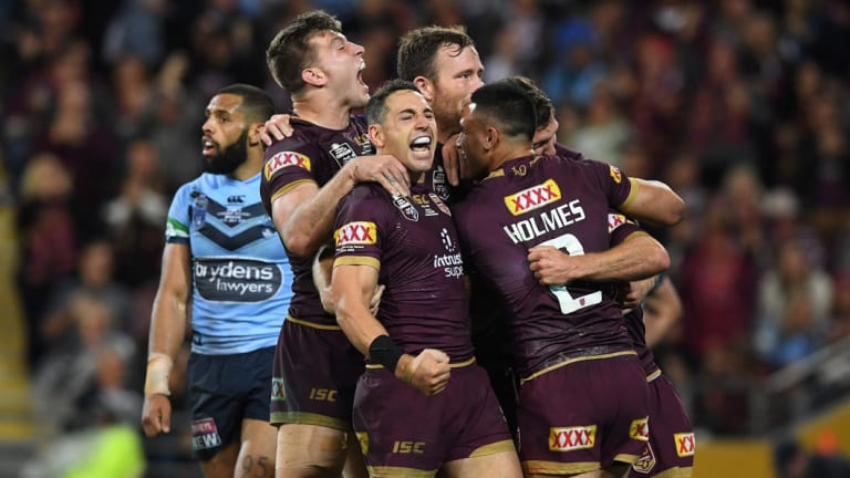 Team spirit: Billy Slater reacts after Daly Cherry-Evans scores the match-sealer.