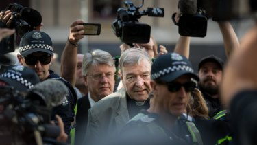 George Pell arrives at the County Court on Wednesday.