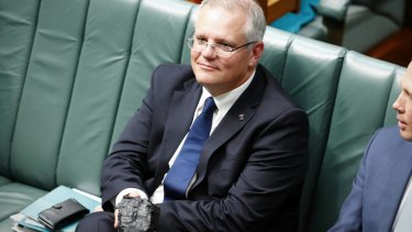 Prime Minister Scott Morrison holding a  lump of coal during question time in 2017.