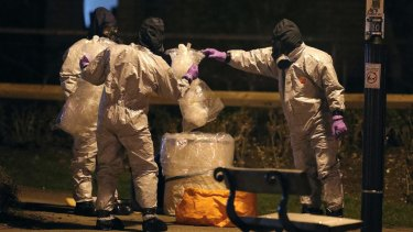 Investigators in protective suits at the scene of the nerve agent attack in Salisbury, England.