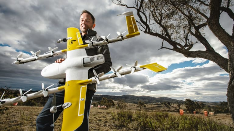 Wing's chief executive James Ryan Burgess with one of the delivery drones, which are set to fly in Canberra's northern suburbs.