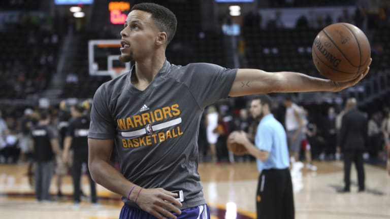 Golden State Warriors' Stephen Curry shoots during warm-ups.
