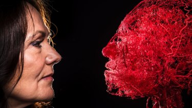 Dr Angelina Whalley, wife of the inventor of plastination, Gunther von Hagens, with a platinated head showing the configuration of blood vessels.