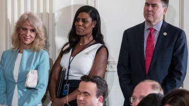 Adviser Kellyanne Conway (left) with former aide Omarosa Manigault and White House Communications Director Mike Dubke in April, 2017.