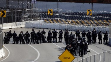 US Customs and Border Patrol officers form a line along the San Ysidro border crossing.