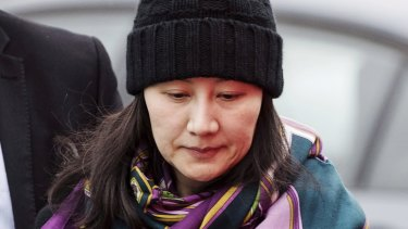 Huawei chief financial officer Meng Wanzhou is accused by the United States of both bank fraud and wire fraud. She is under house arrest and wears a GPS monitor.