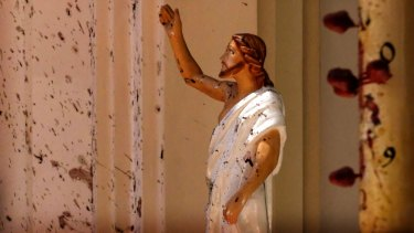 Blood stains are seen on the wall and on a Jesus Christ statue at the St Sebastian's Church near Colombo, Sri Lanka.