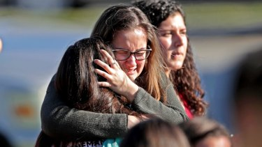 Students released from a lockdown embrace following a shooting at Marjory Stoneman Douglas High School in Parkland, Florida.