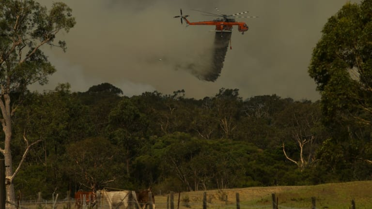 A waterbombing aircraft tackles a blaze in NSW during 2017.