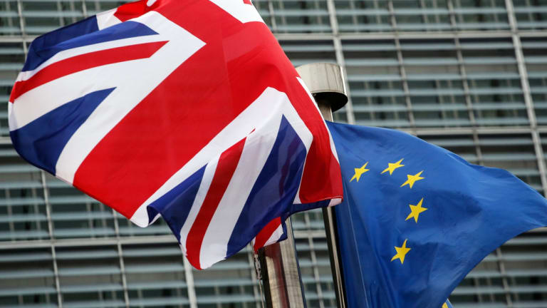 A Union flag, also known as a Union Jack, left, flies next to a European Union (EU) flag outside the European Commission building in Brussels, Belgium.
