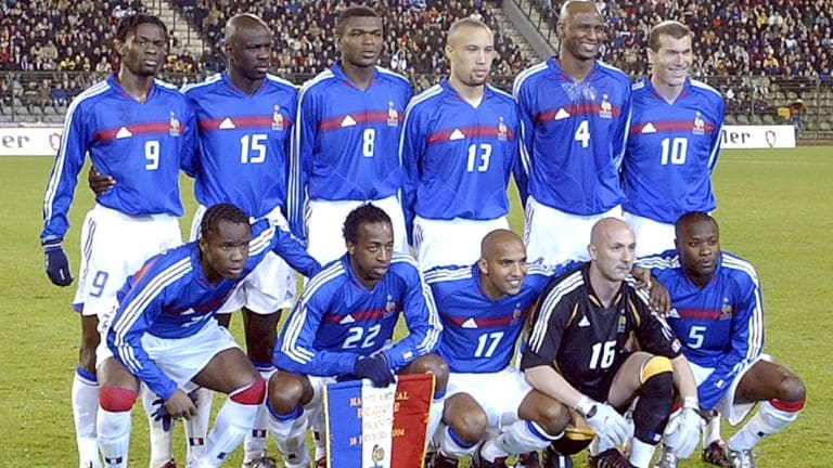In 2004, Louis Saha (#9), poses with the French national soccer team in a photo which includes Zinedine Zidane (#10), Patrick Vieira (#4), William Gallas (#5) and Marcel Desailly (#8).