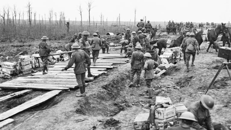 Members of the 2nd Australian Pioneer Battalion build a wagon track from planks at Chateau Wood during World War One.