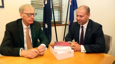 Commissioner Kenneth Hayne and Treasurer Josh Frydenberg, right, with the final report from the Royal Commission into misconduct in the Banking, Superannuation and Financial Services Industry.